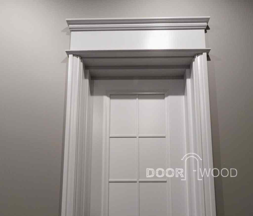 Деревянные двери с поталом
